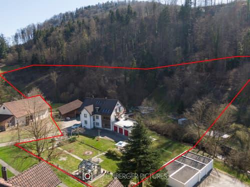 Bauland mit 3-Familien-Anwesen