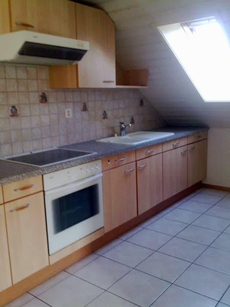 Bel appartement de 3 1/2 pièces dans les combles avec cheminée