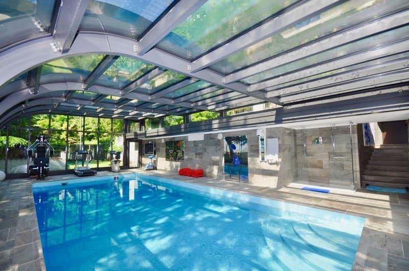 Villa di pregio con ampio giardino, piscina e vista sul Lago di Lugano