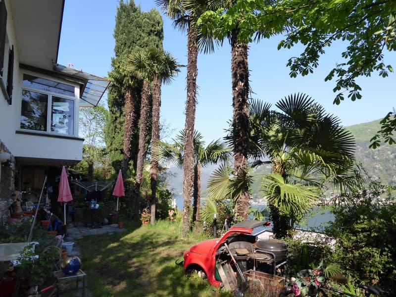 Bestehendes Haus mit Terrasse vor EG