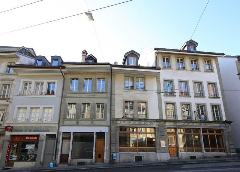 Maison d'habitation avec appartement de 6.5 et surface commerciale située dans le quartier du Bourg à Fribourg
