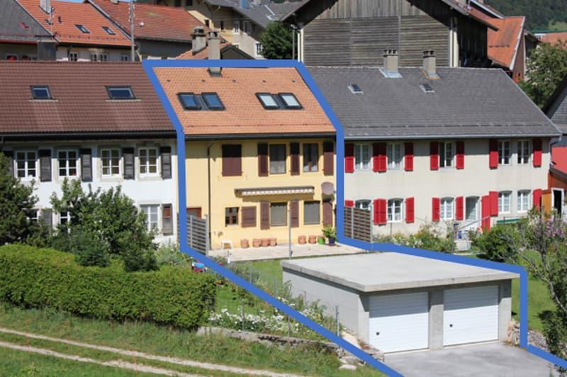 Grande maison jumelée avec garage