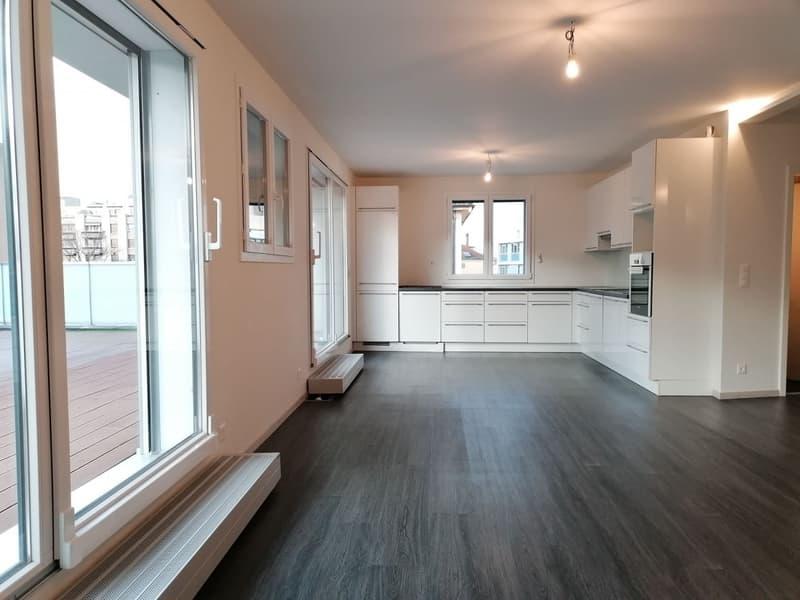 Appartement en attique à Chêne-Bourg avec grande terrasse