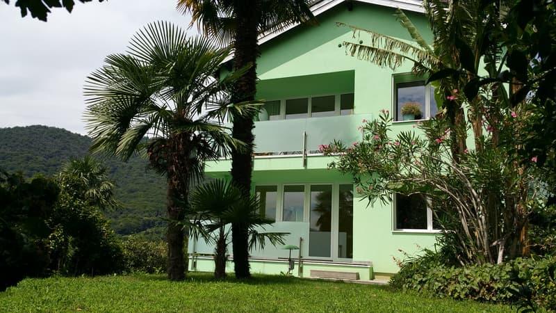 3.5 locali al 1P, Neggio, nel verde, giardino privato, vista lago, 3min da centri commerciali
