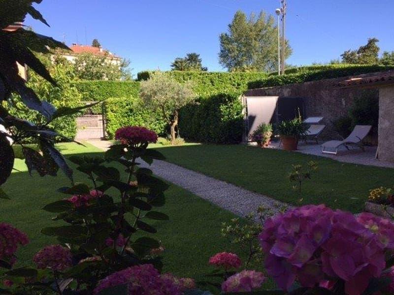 Collina D'Oro Gentilino : raffinata villa con giardino