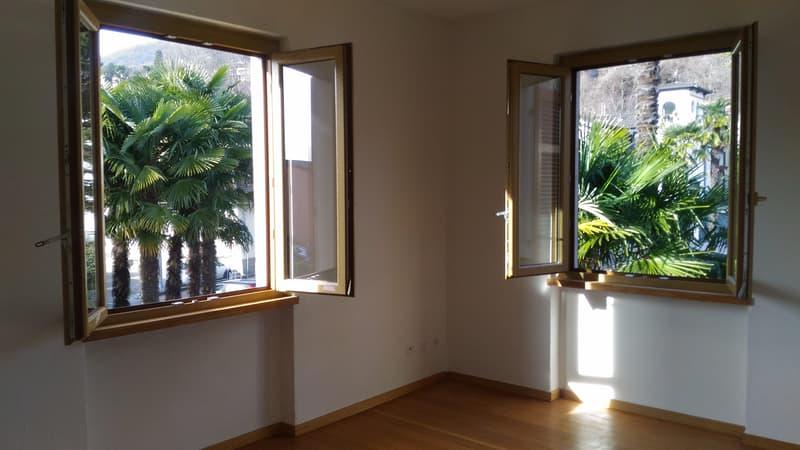 A Caslano luminoso appartamento 3.5 locali con grande giardino privato