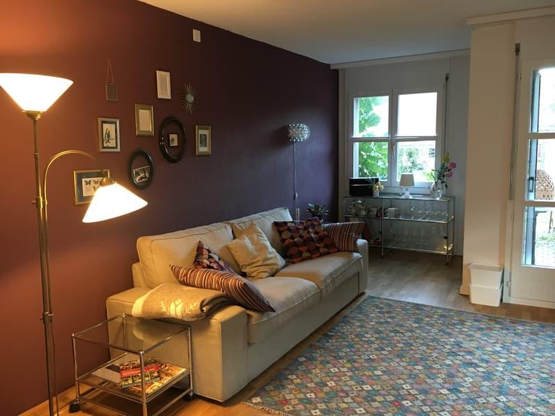 Wohnung mit Gartensitzplatz, offener Wohnküche und Mitbenutzung Gemeinschaftsraum