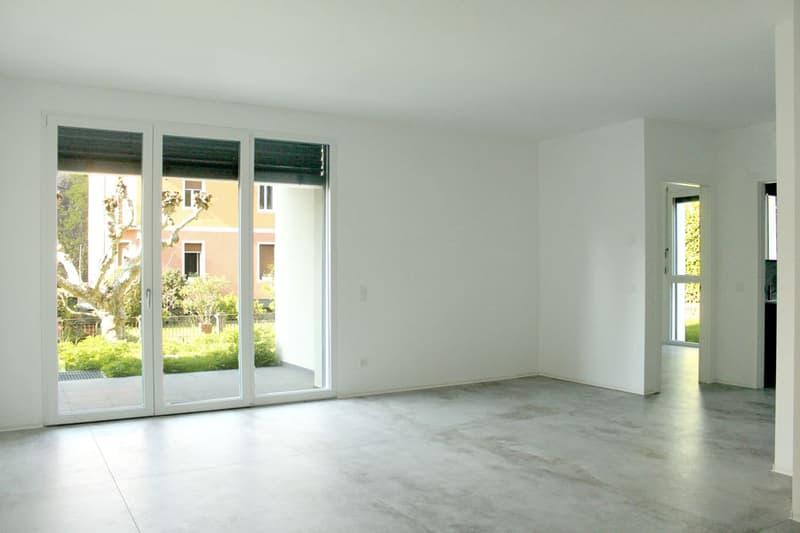 Nuovo appartamento 3,5 locali con terrazza coperta e giardino privato.