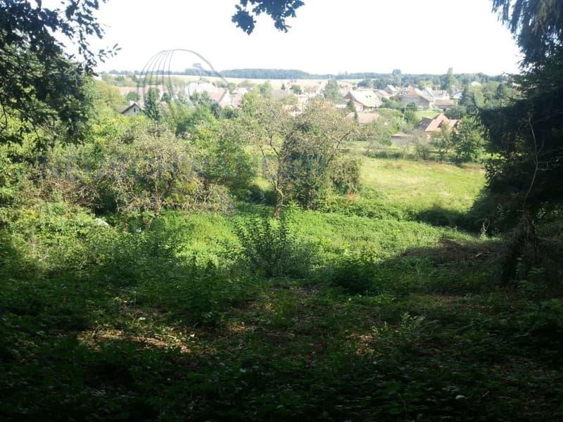 Grand terrain à bâtir dans cartier résidentiel, calme et proche du centre
