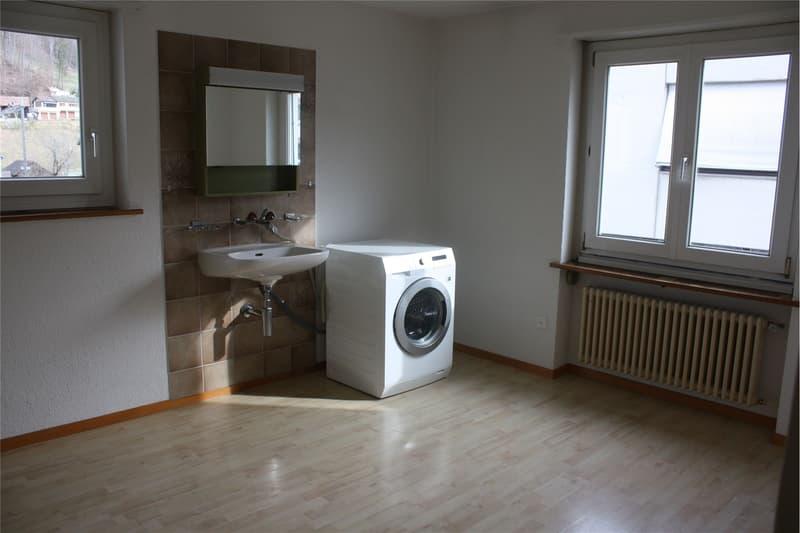 Zimmer mit Waschmaschine