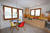 Küche mit Frühstückstisch und Ausgang